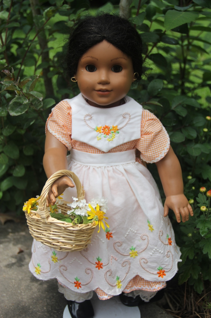 the dress was made from a daisy kingdom pattern and the embroidery designs were from one of kathy harrisons awesome collection - The Doll In The Garden