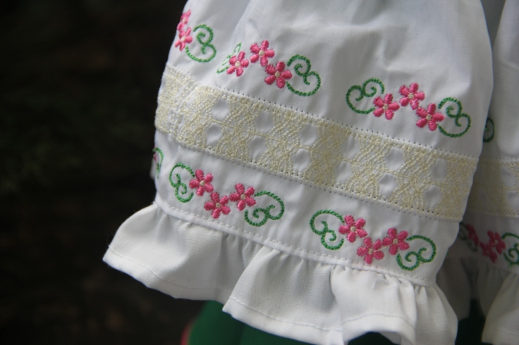 Embroidered doll apron from Stitching with Elli- design from thread n scissors