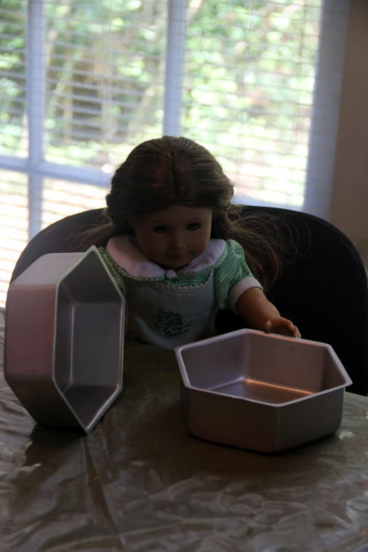 """The dolls bake a cake on the """"Stitching with Ellie"""" blog"""