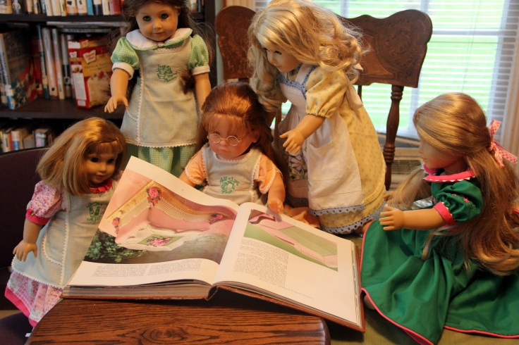 "The dolls bake a cake on the ""Stitching with Ellie"" blog"