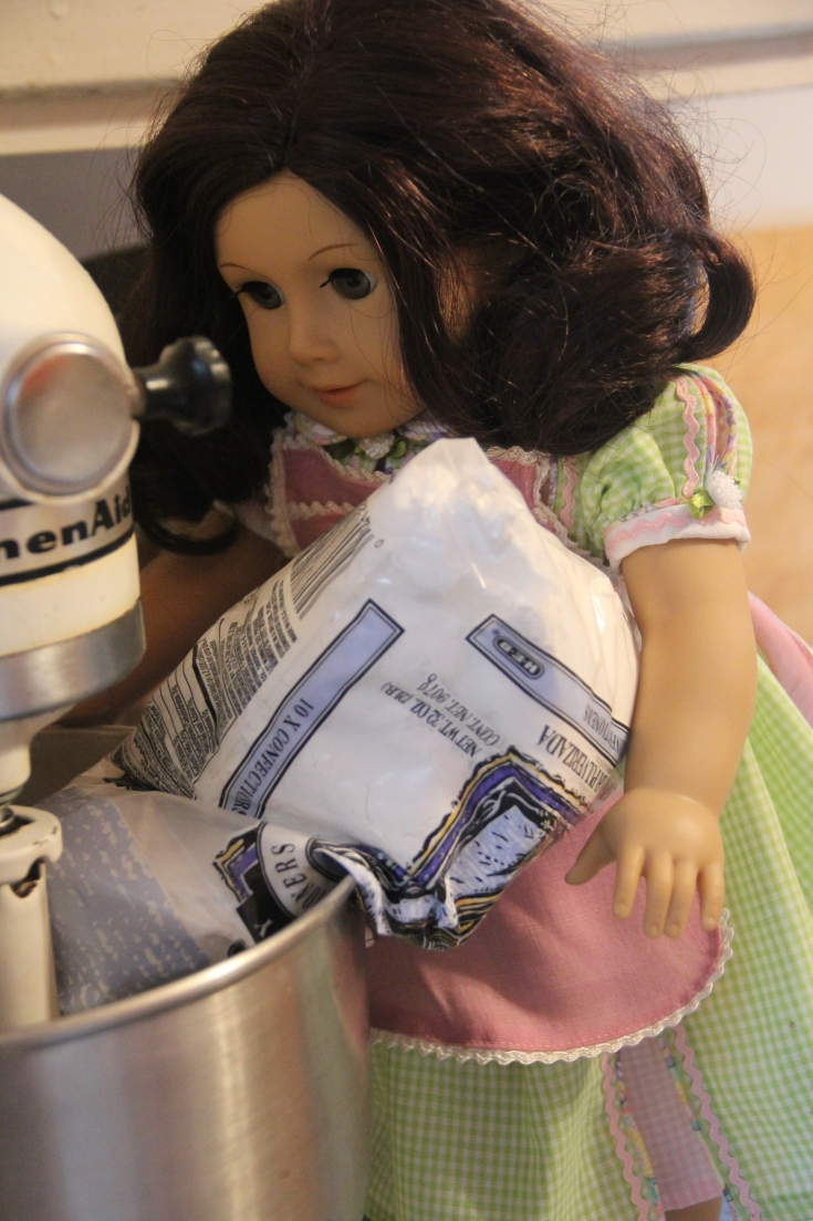 """Ruthie adds the powdered sugar- The dolls decorate a cake! 18"""" doll adventure on Stitching with Elli"""