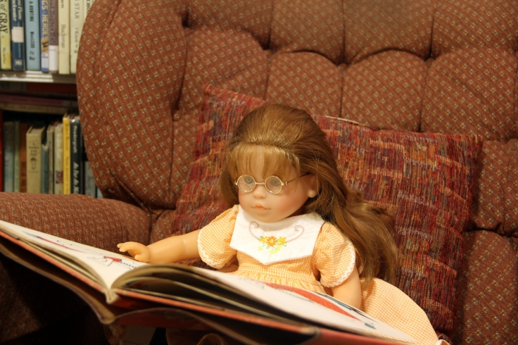 "The dolls reading a book- see the rest of the story about how they bake a cake on the ""Stitching with Ellie"" blog"