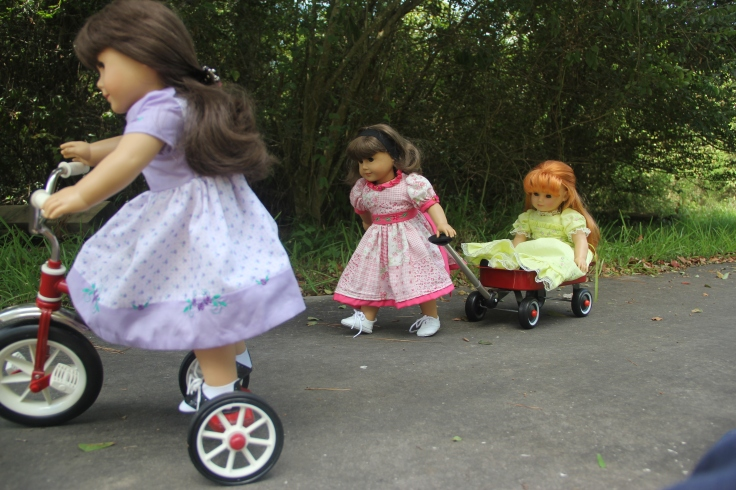 "Summer for Samanta and Susan. The dolls loved playing with the tricyle and the wagon- a 18"" doll adventure by Stitching with Elli"