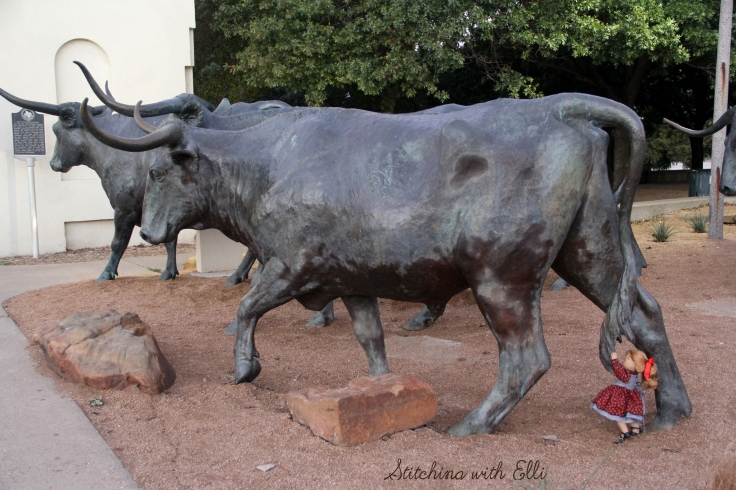 "Playing with the cow statues in Waco Texas- a 18"" doll photo story by Stitching with Elli"