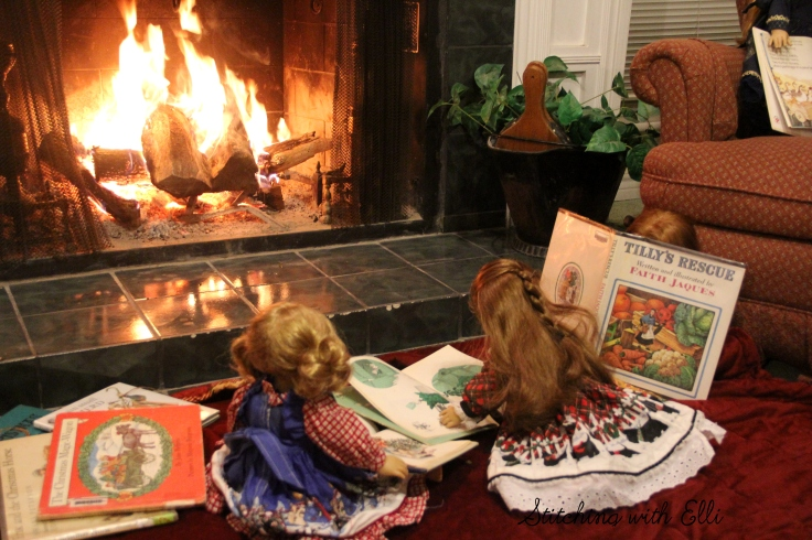 Reading Christmas books by the fire- Christmas with American Girls by Stitching with Elli