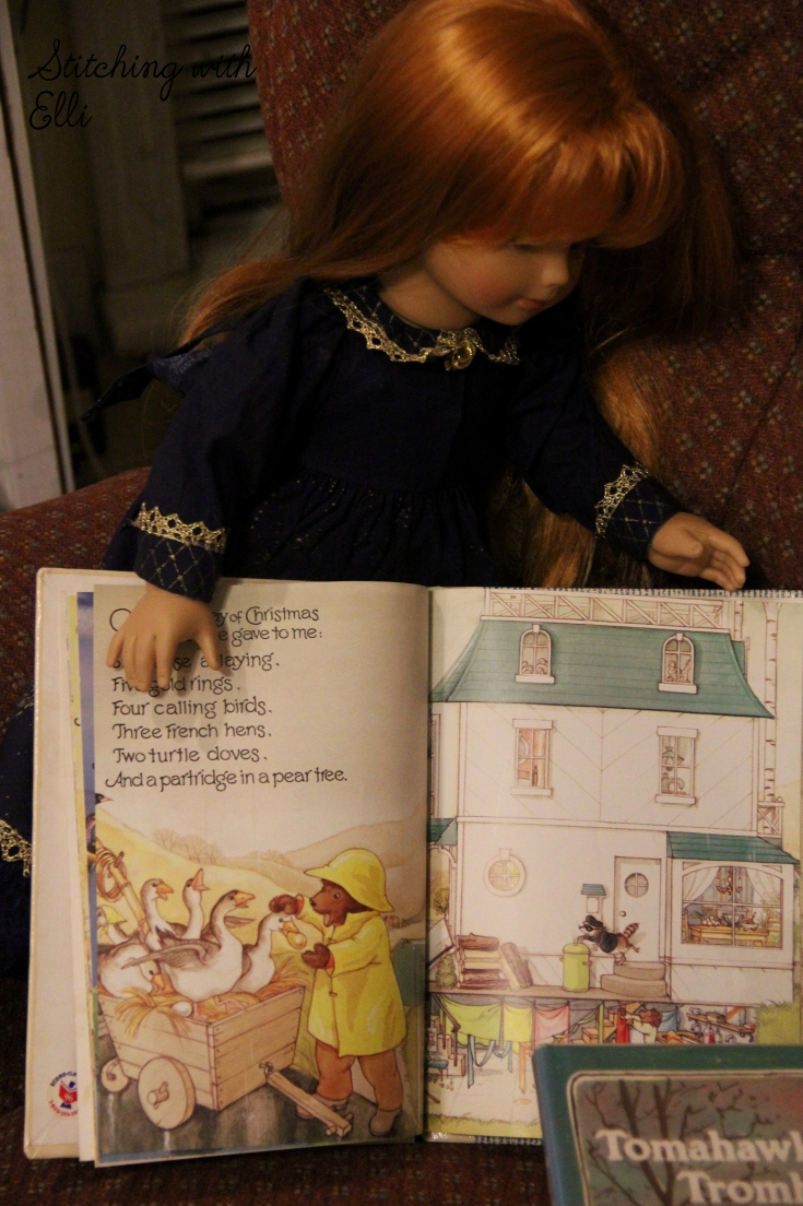 The dolls read Christmas stories- by stitching with Elli