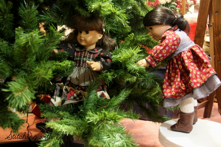 Josefina and Susan fluff up the Christmas tree- an American Girl Christmas story by Stitching with Elli