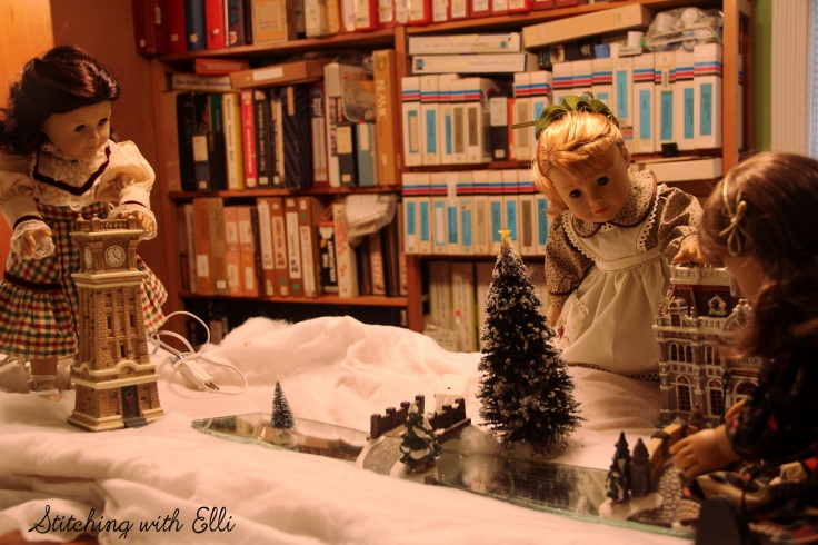 Setting up a Christmas village! Susan and Maryellen are hard at work- by Stitching with Elli