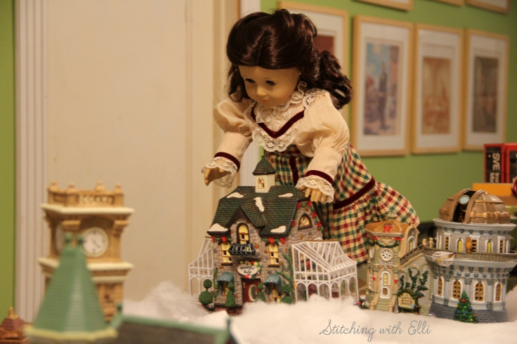 Setting up a Christmas village! Ruthie adjusts the greenhouse- by Stitching with Elli