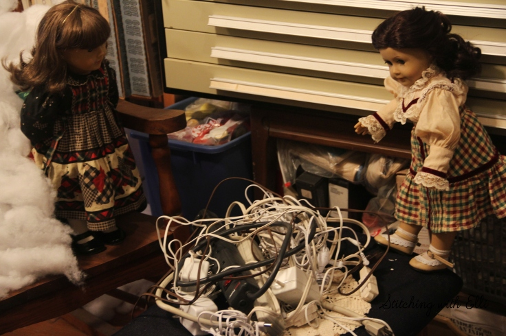 Setting up a Christmas village..what are we supposed to do with all these cords??- by Stitching with Elli