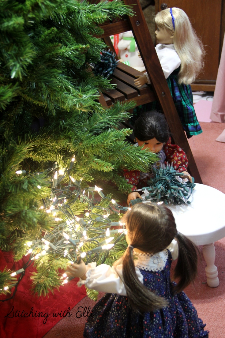 Briget puts the lights on the tree- an American girl  Christmas photostory by Stitching with Elli
