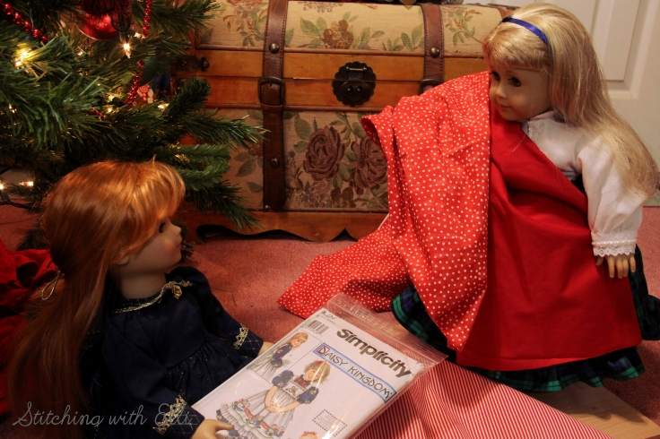 The dolls are sewing a dress for a Christmas present-  by Stitching with Elli