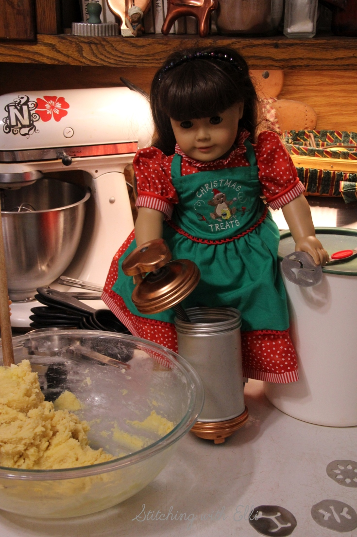 Ellen is baking Spritz cookies- a Christmas doll story by Stitching with Elli