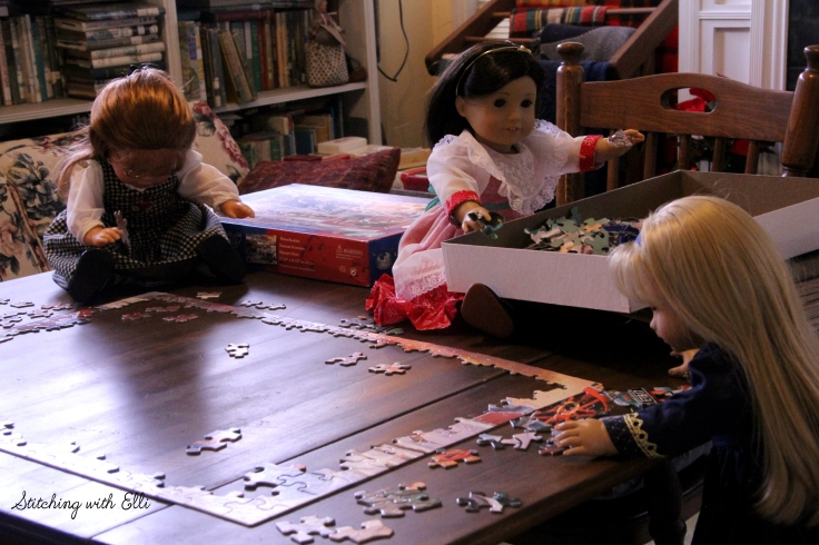 Spending time together working on a puzzle is a fun thing to do around Christmas time- by Stitching with Elli