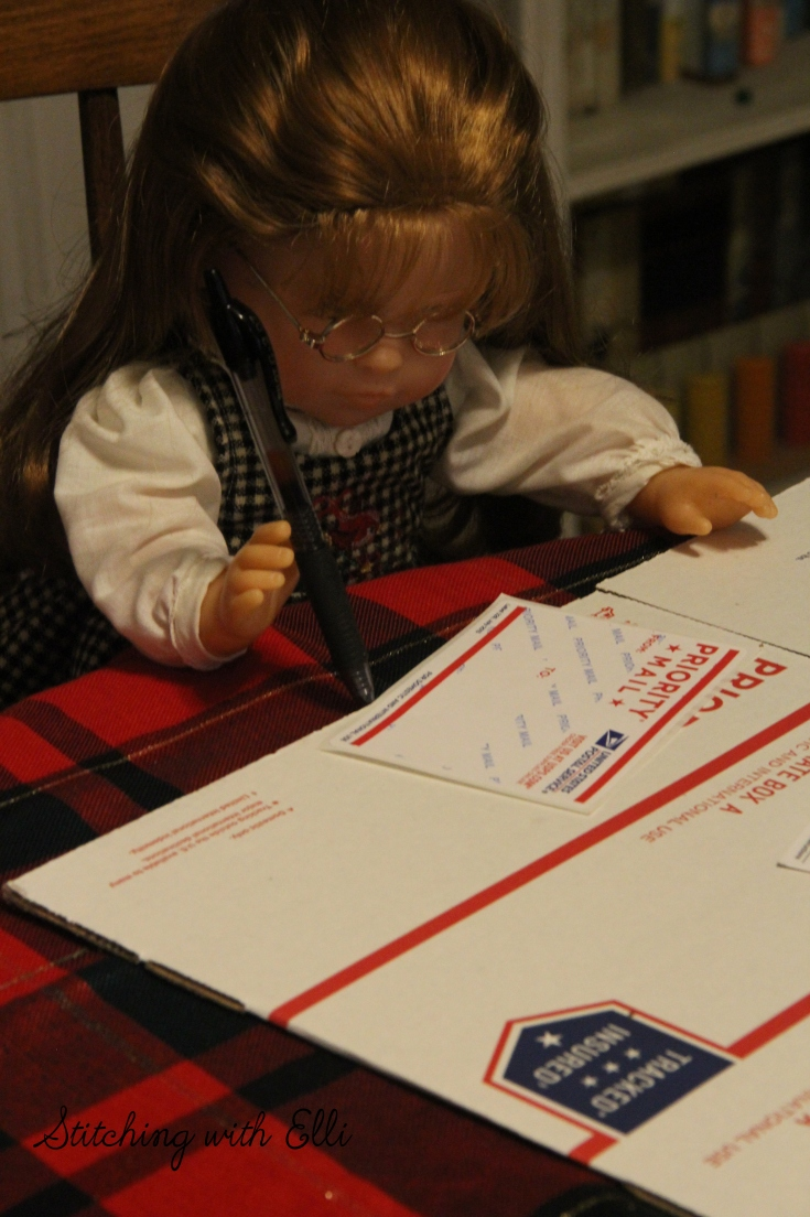 Ellen is address a package to a soldier- a American girl photo story by Stitching with Elli