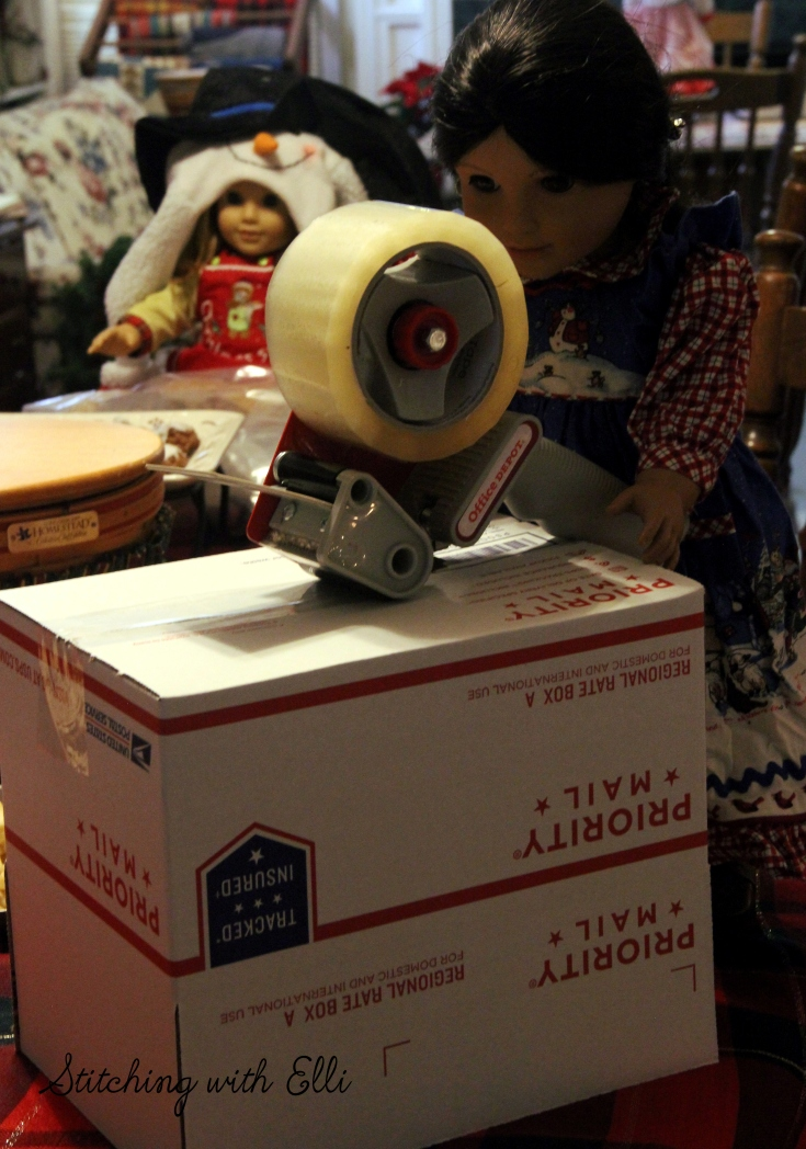 Josefina tapes up the box for the soldiers- American Girl photo story by Stitching with Elli