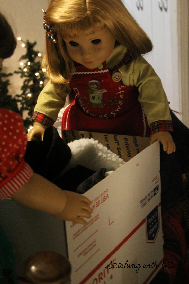 Nellie is packing the box for the soldiers- American Girl photo story by Stitching with Elli