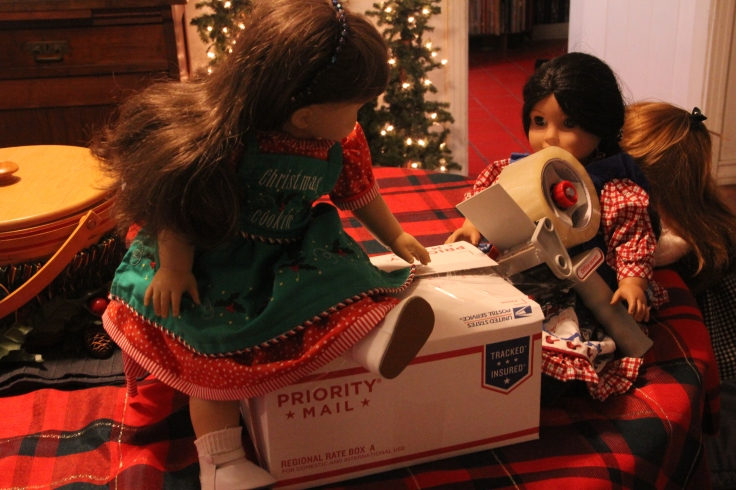 Samantha is getting ready to pack the box for the soldiers- American Girl photo story by Stitching with Elli