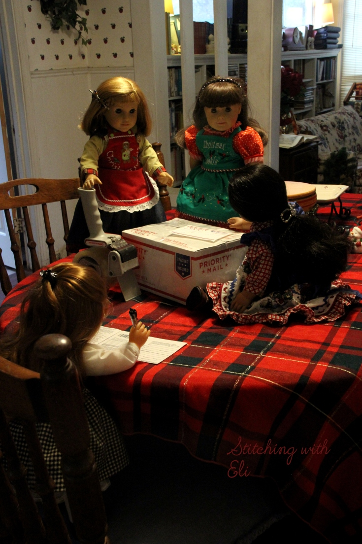 Packing up cookies to go to the soldiers for Christmas- American Girl photo story by Stitching with Elli