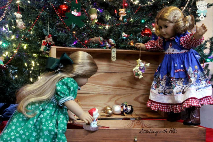 Elizabeth and Debbie help hang the ornaments on the tree- an American girl story by Stitching with Elli