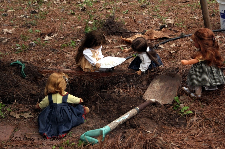 """Adding egg shells for fertilizer  to the hole, the dolls plant a garden- a 18"""" doll adventure by Stitching with Elli"""