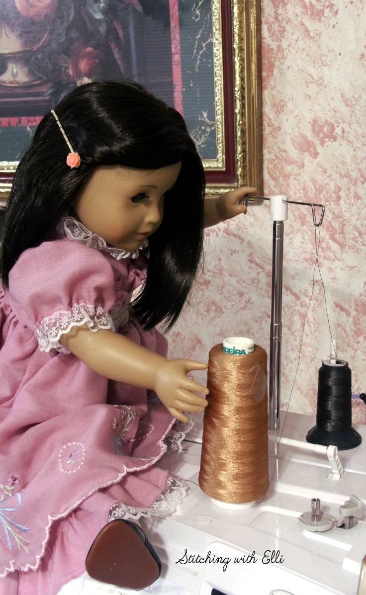 Rose (an american girl doll) is busying threading her Ellisimo sewing machine- See more stories on my blog www.stitchingwithelli.com