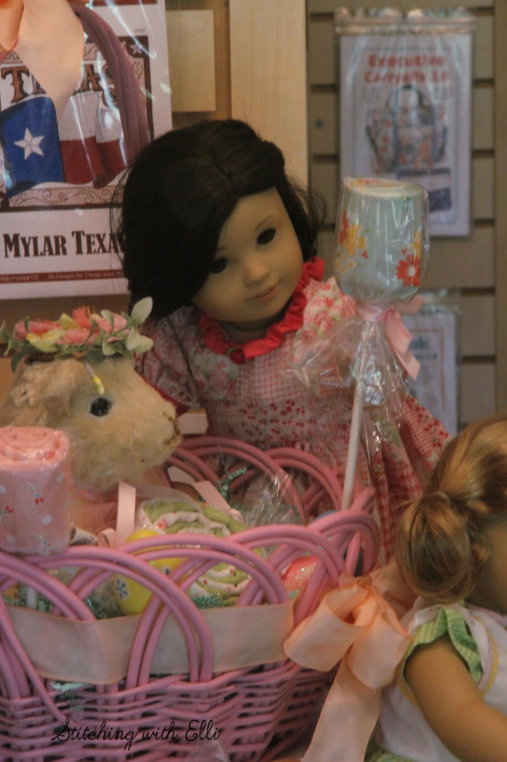Dolls in a scrapbooking store- see the whole story on www.stitchingwithelli.com
